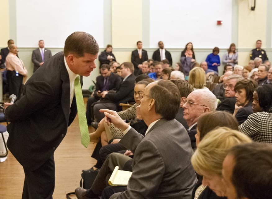 "Mayor Martin J. Walsh turned to the interim transportation commissioner, Jim Gillooly, to respond to a concern about a crosswalk during ""Mondays with the Mayor."" The town hall question-and-answer session was held at a school in Brighton."